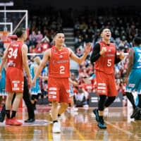 Chiba's Shigehiro Taguchi (right) celebrates in the fourth quarter of his team's 87-84 win over Kyoto on Sunday at Funabashi Arena. | B. LEAGUE
