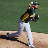 Ryan Cook pitches for the Oakland Athletics in a March 2012 spring training game. | UCINTERNATIONAL / WIKIMEDIA COMMONS