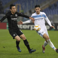 Frankfurt's Makoto Hasebe (left) challenges for the ball against Lazio's Joaquin Correa during a Europa League match on Thursday in Rome. Frankfurt announced on Sunday that it had signed Hasebe to a one-year extension which would keep him with the club through the 2019-20 season. | AP