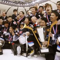 The Cranes, seen celebrating after winning the 2010 All Japan Ice Hockey Championship in Tomakomai, Hokkaido, will disband at the end of the current season. | KYODO