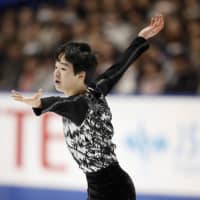 Yuma Kagiyama performs during the men's free skate at the national championships on Monday in Kadoma, Osaka Prefecture. The 15-year-old finished in sixth with 216.36 points. | KYODO