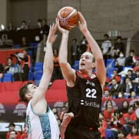 Nick Fazekas (right) attempts a shot during the first quarter of Japan's FIBA World Cup qualifier against Kazakhstan on Monday night in Toyama. | KYODO