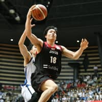 Yudai Baba goes up for a shot during Japan's contest against Qatar on Friday at Toyama City Gymnasium. Baba scored 13 points and pulled down seven rebounds in the win. | KYODO