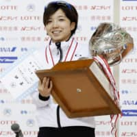 Speed skater Nao Kodaira poses her trophy after winning a sixth national sprint championship title in Obihiro, Hokkaido on Sunday. | KYODO