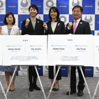 Tokyo 2020 organizing committee member Tomoko Hagiwara (second from left) attends a news conference on Tuesday where the finalists for Olympic volunteers' official nickname were unveiled. | KYODO
