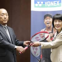 Tetsuo Osaka presents a tennis racket to Hokkaido Governor Harumi Takahashi in Sapporo on behalf of his granddaughter, reigning U.S. Open champion Naomi Osaka. The World No. 5 donated 30 rackets to the prefecture, which was hit by a deadly earthquake in September.   KYODO