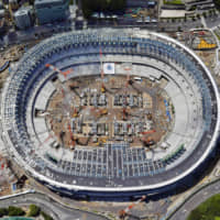 The construction of Tokyo's new National Stadium is seen from above on July 24. | KYODO