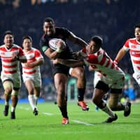 The Brave Blossoms received a test of their development for the 2019 Rugby World Cup against Joe Cokanasiga (center) and England on Nov. 17 in Twickenham, England. | REUTERS