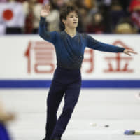 Shoma Uno acknowledges the crowd after completing his routine on the second day of the NHK Trophy in Hiroshima on Nov. 10. | KYODO