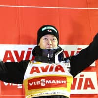 Ski jumper Ryoyu Kobayashi waves to fans after finishing third in Saturday's FIS World Cup event in Nizhny Tagil, Russia. | KYODO