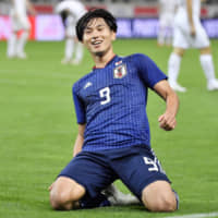 Takumi Minamino scored two goals for the Samurai Blue in a 4-3 victory over Uruguay in October and is one of the bright hopes for the future of the national team. | KYODO