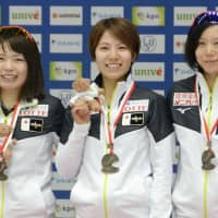 Ayano Sato (left) Konami Soga (center) and Miho Takagi stand on the podium after winning the  team sprint at an ISU World Cup event on Sunday in Tomaszow Mazowiecki, Poland. | KYODO