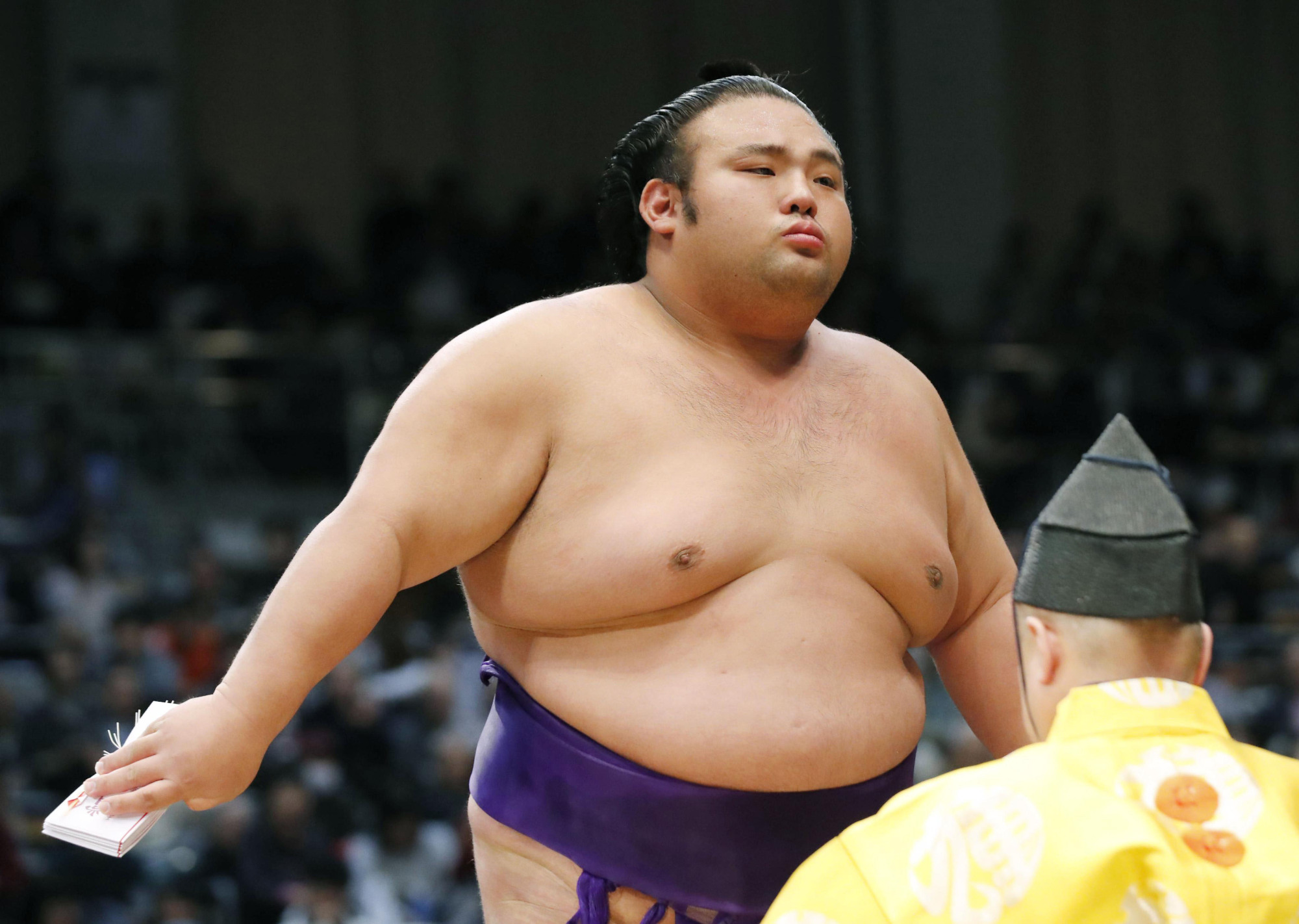 Takakeisho became the first wrestler since Hakuho in May 2006 to win a first title before the age of 23 when he swept through the competition with a 13-2 record to win the Kyushu Grand Sumo Tournament in November. | KYODO