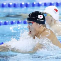 Yasuhiro Koseki competes in the men's 100-meter breaststroke final at the FINA Short Course World Swimming Championships on Wednesday in Hangzhou, China. | KYODO