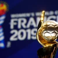 The Women's World Cup trophy is seen during the draw for the tournament on Saturday in Paris. | AFP-JIJI