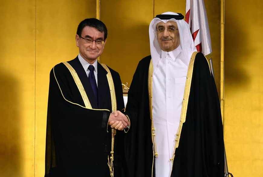 Qatari Ambassador Hassan Bin Mohammed Rafei Al-Emadi (right) shakes hands with Foreign Minister Taro Kono (left) during a reception to celebrate the anniversary of  Sheikh Jassim Bin Mohamed Bin Thani
