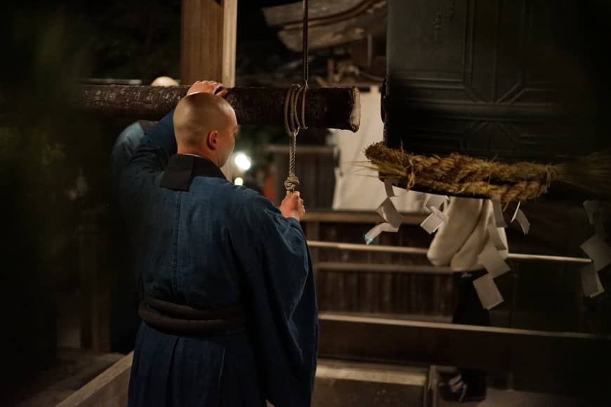 A monk of Kenchoji temple in Kamakura prepares for the <em/>joyo-no-kane rite at midnight. At many temples, a large bell is run 108 times.