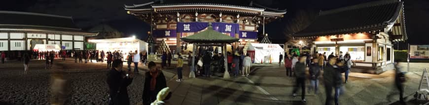 Visitors to Ikegami Honmonji burn incense before entering the temple to pray for good luck in the new year.