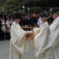Priests carry the o-mamori to the blessed and burned.