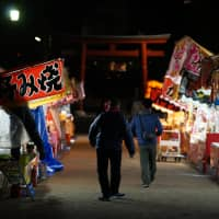 Stalls selling traditional festival fare prep for the long evening at Kenchoji, a temple in Kamakura.