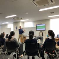 The joy of learning: James Hill teaches a class of returnee students. The author and educator says that it's important to keep classes on philosophy fun so that students don't develop a negative relationship with thinking.