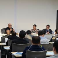 Panelists hold a discussion on education and regional revitalization in a symposium co-hosted by the Japan Times Satoyama Consortium in Jinsekikogen, Hiroshima Prefecture, on Oct. 20. | SHINOBU YAMADA