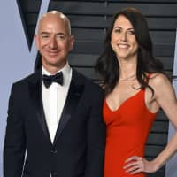 Jeff Bezos and wife MacKenzie Bezos arrive at the Vanity Fair Oscar Party in Beverly Hills, California, last March. Bezos says he and his wife, MacKenzie, have decided to divorce after 25 years of marriage. Bezos, one of the world's richest men, made the announcement on Twitter Wednesday. | EVAN AGOSTINI / INVISION / VIA AP