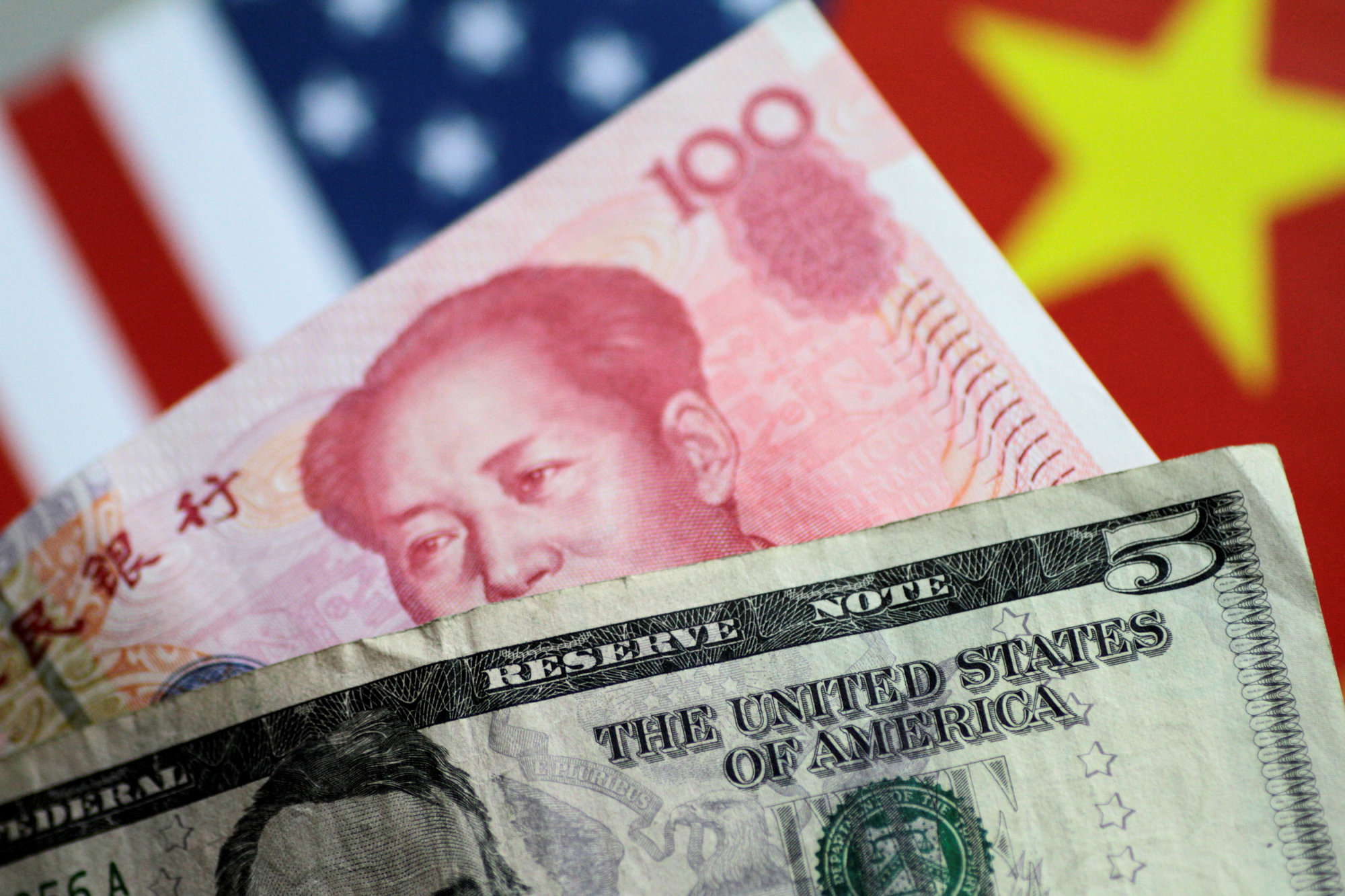 U.S. dollar and China yuan notes are seen in 2017. | REUTERS