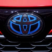 Toyota's logo is seen during the first press day at the Paris Motor Show on Oct. 2. | REUTERS