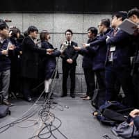 Yusuke Otsuka, former chief operating officer at cryptocurrency exchange Coincheck Inc., speaks to the media in the lobby of the building housing the company's headquarters in Tokyo on Feb. 13 last year. The previous month Coincheck lost clients' investments, worth at the time about ¥58 billion, due to a hacking incident. | BLOOMBERG