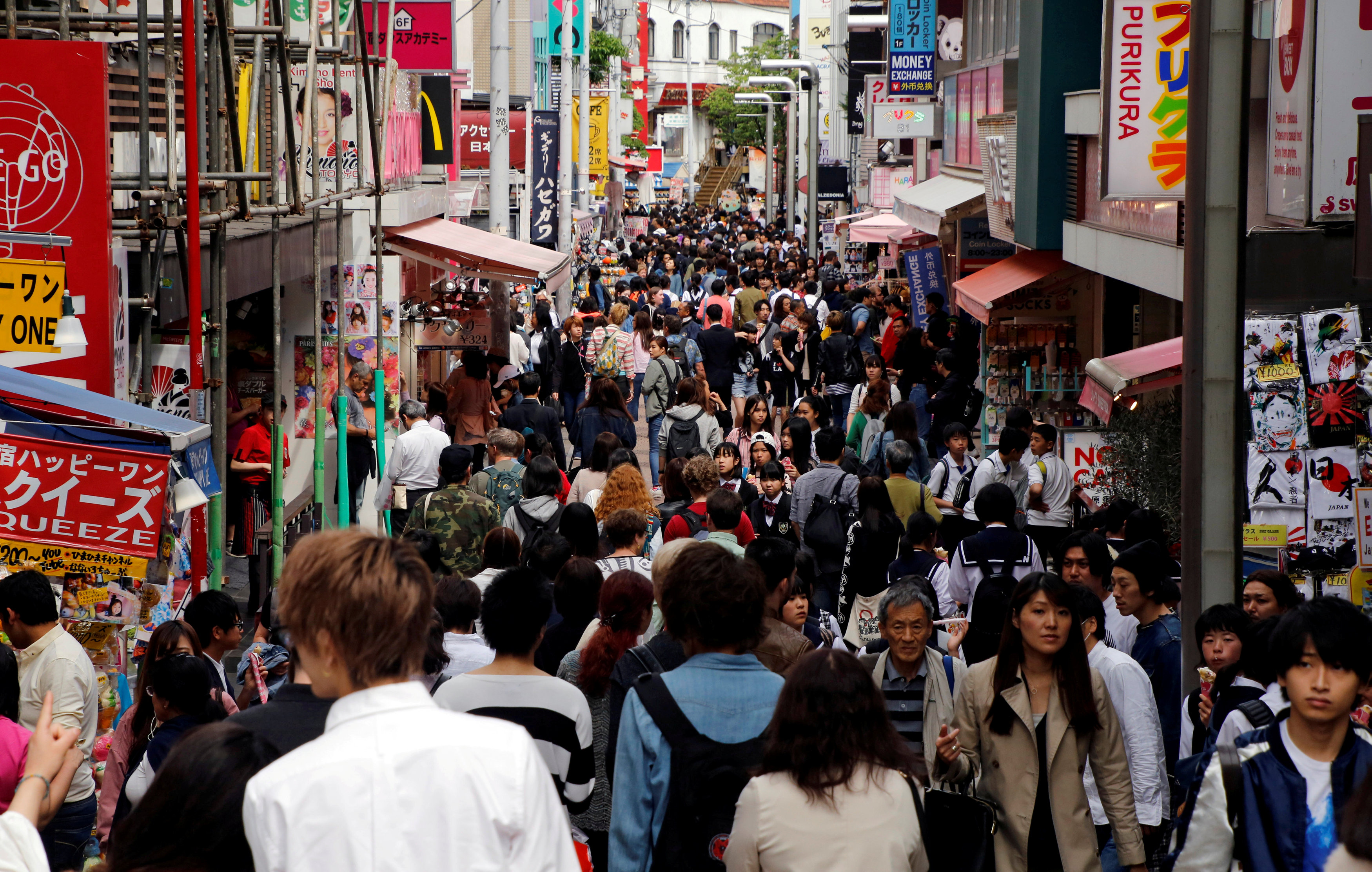 People shop in Tokyo's Harajuku district. The Japanese economy is thought to have counted its 74th consecutive month of improvement since December 2012. | REUTERS