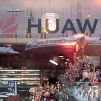 The logo of Huawei Technologies Co. Ltd. is seen in the window of a pop-up office ahead of the World Economic Forum (WEF) in Davos, Switzerland, on Monday. | BLOOMBERG