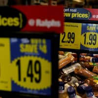 Price tags are pictured at a Ralphs grocery store, which is owned by Kroger Co., ahead of company results in Pasadena, California, in 2016. | REUTERS