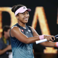 Naomi Osaka reacts after winning the Australian Open on Saturday. | REUTERS