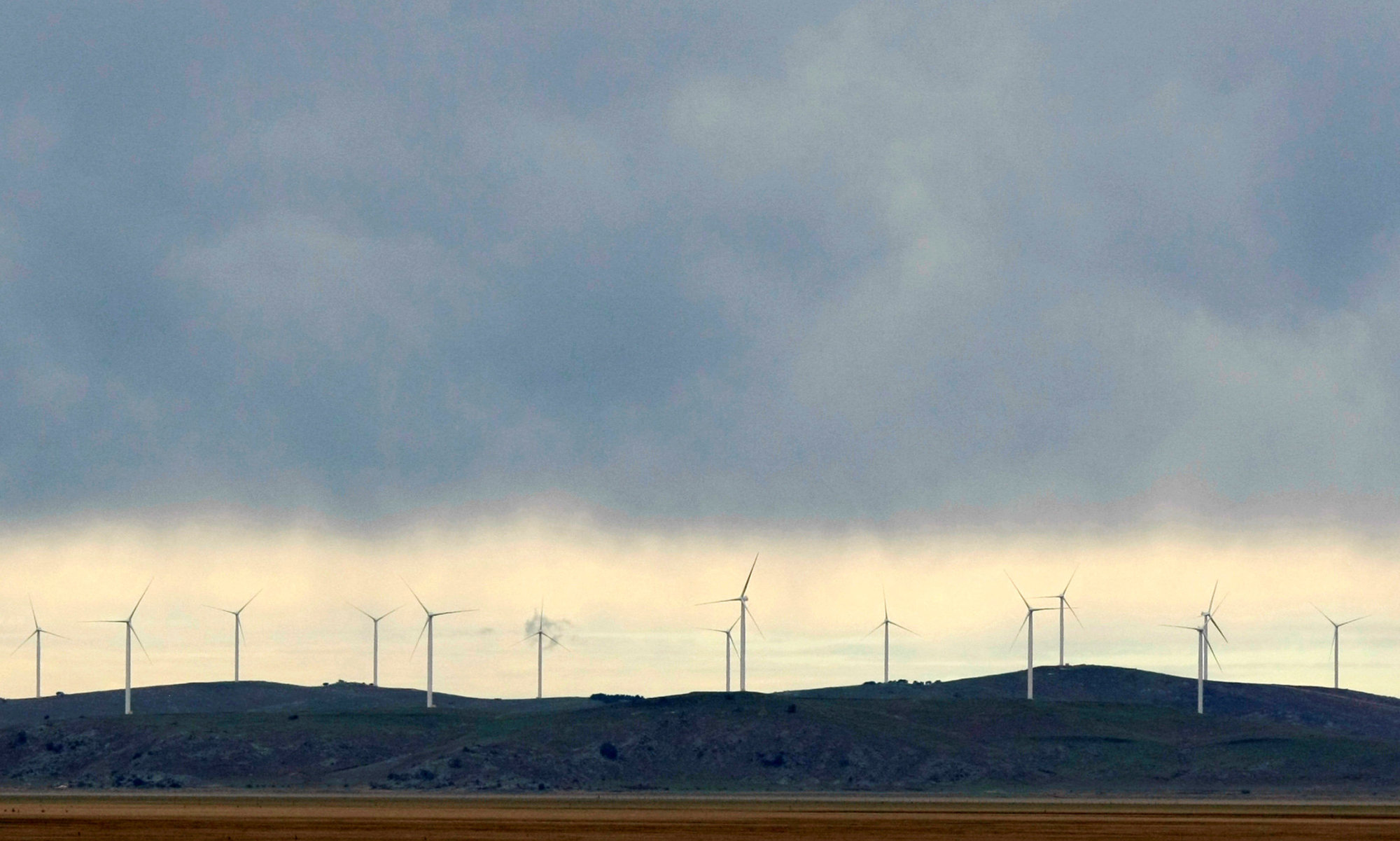 Newly constructed wind turbines stand on a hillside at Lake George, north of Canberra, in 2009.   REUTERS