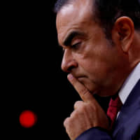 Carlos Ghosn, then CEO of the Renault-Nissan alliance, reacts during a news conference in Paris in September 2017. | REUTERS
