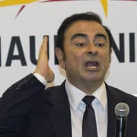 Then-Renault-Nissan CEO Carlos Ghosn speaks during a press conference held at Auto China 2016 in Beijing in 2016. A court in Tokyo on Tuesday rejected Ghosn's latest request for bail, made more than two months after his arrest, prolonging a detention that has brought Japan's harsh justice system under international scrutiny. | AP