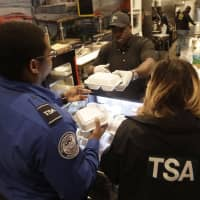 Chef Creole owner Wilkinson Sejour hands out free hot meals to TSA workers at his restaurant at Miami International Airport Tuesday in Miami. The restaurant is offering free lunch and dinner to federal airport employees affected by the government shutdown. | AP