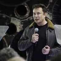 SpaceX founder and chief executive Elon Musk speaks at an event to announce the name of the person who would be the first private passenger on a trip around the moon, in Hawthorne, California, last September. SpaceX will lay off 10 percent of its roughly 6,000 workers, announcing Friday that it needs to become leaner to accomplish ambitious projects such as creating a spaceship that can carry astronauts to Mars. | AP