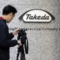 Takeda Pharmaceutical Co. is expanding a push to cut debt after its takeover of Shire PLC. | BLOOMBERG