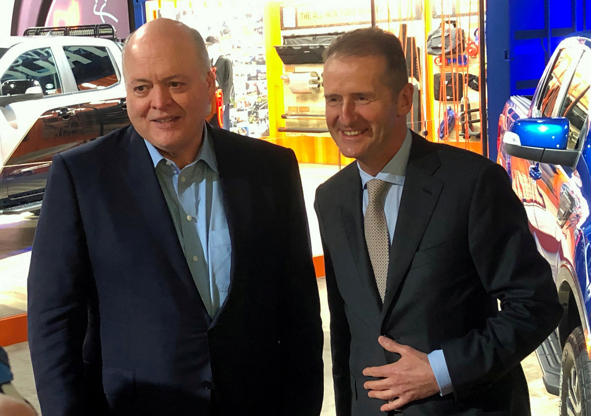 The president and CEO of Ford, Jim Hackett, poses with Volkswagen CEO Herbert Diess at the North American International Auto Show in Detroit on Monday. | REUTERS