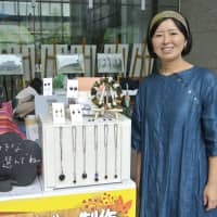 Workshop wares: Satoyama recently displayed her wares in Tokyo's Chiyoda Ward, where she also held a workshop teaching people how to make charcoal ornaments.   KYODO