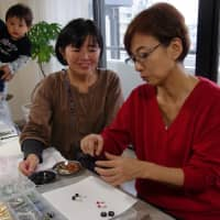 Capital coal: In November, Setoyama taught people how to make charcoal accessories at an event in Tokyo's Omotesando district.   KYODO