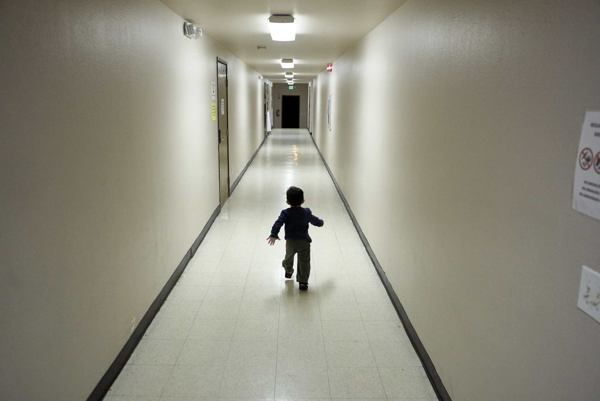 An asylum-seeking boy from Central America runs down a hallway after arriving from an immigration detention center to a shelter in San Diego, California, Dec. 11. The Trump administration expects to launch a policy as early as Friday that forces people seeking asylum to wait in Mexico while their cases wind through U.S. courts, an official said, marking one of the most significant changes to the immigration system of Donald Trump's presidency. | AP