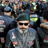 A member of the Iraq Bikers, the first Iraqi biker group, poses for a photograph before riding his motorbike on the streets of Baghdad on Dec. 28. | REUTERS