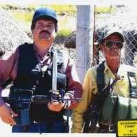 In this undated photo provided by the United States Attorney's Office for the Eastern District of New York, Joaquin 'El Chapo' Guzman (left) poses with an unidentified man. Text messages sent by the Mexican drug lord known as El Chapo about narrowly avoiding capture in 2012 have become the latest damaging evidence at his U.S. trial. Prosecutors presented the texts Wednesda in federal court in Brooklyn, where Guzman has pleaded not guilty to drug-trafficking charges. | UNITED STATES ATTORNEY'S OFFICE FOR THE EASTERN DISTRICT OF NEW YORK / VIA AP