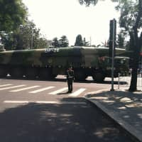 China's DF-26 ballistic missile is seen after a military parade in Beijing to commemorate the 70th anniversary of the end of World War II on Sept. 3, 2015. | ICEUNSHATTERED, VIA WIKIMEDIA COMMONS / CC-BY-SA-2.5