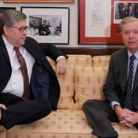 Incoming Senate Judiciary Committee Chairman Lindsey Graham (R-SC) meets with U.S. Attorney General nominee William Barr (left) in Washington Jan. 9. | REUTERS