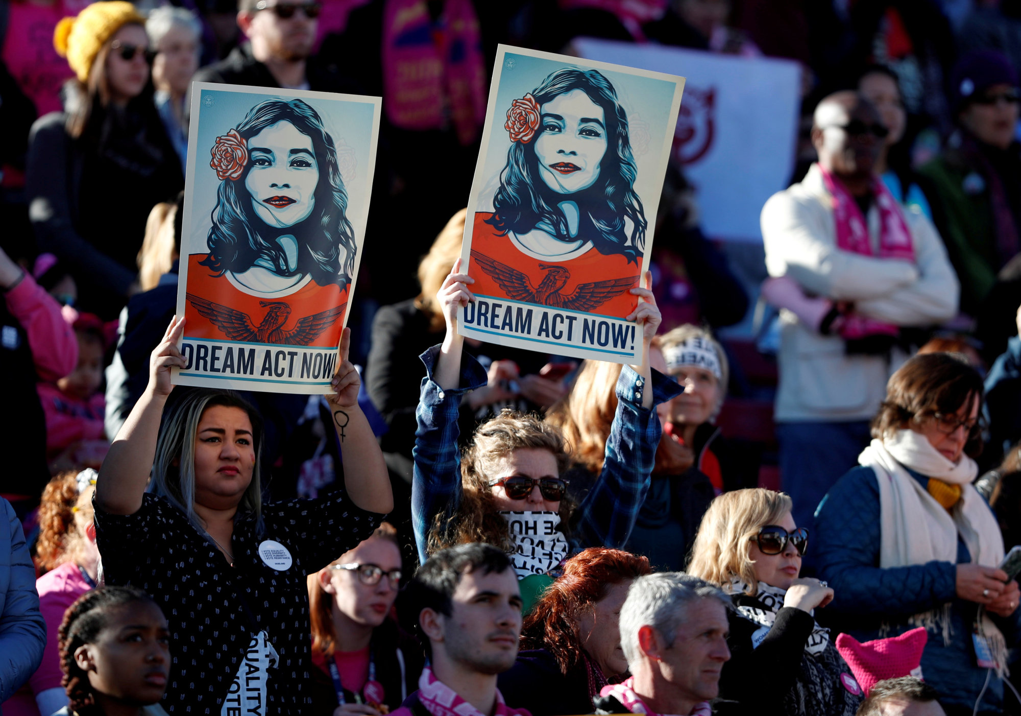 Supporters of Deferred Action for Childhood Arrivals (DACA) hold signs during the Women's March rally in Las Vegas last January. | REUTERS