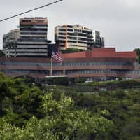 The U.S. Embassy building in Caracas is seen Thursday, a day after Venezuelan President Nicolas Maduro broke off diplomatic ties with the U.S.  Maduro announced on Wednesday he was breaking off diplomatic ties with the United States after counterpart Donald Trump acknowledged opposition leader Juan Guaido as the South American country's 'interim president.' | AFP-JIJI